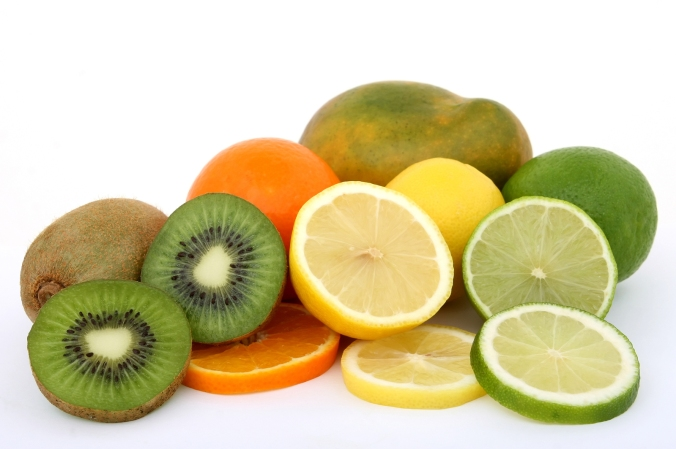 Fruit salad ingredients lemon lime kiwi mango and orange